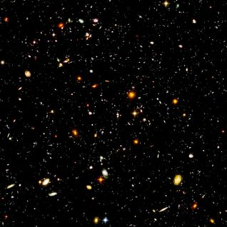 Hubble Ultra-Deep Field image of galaxies in the Fornax constellation, composited from the Hubble Space Telescope.