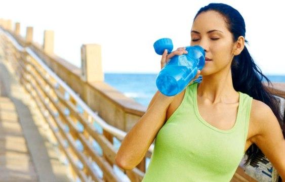 Drinking from water bottle