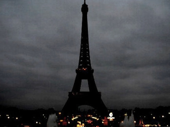The Eiffel Tower with its lights extinguished to honour those killed in the recent attacks