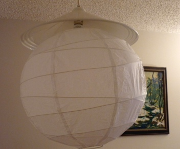 My dining room overhead light, with the original fixture and the lampshade I added